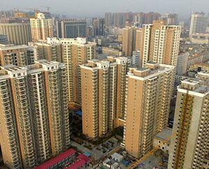 国际英语新闻:Economic Watch: China steps up property controls in smaller cities amid market divergence