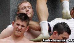 US Naval Academy Students Climb Slippery Monument