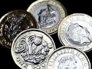 经济学人下载:防止伪造 英国新推一英镑硬币(2)