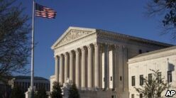 VOA慢速英语:Supreme Court Allows Trump Travel Ban to Take Effect(翻译)