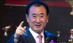 VOA慢速英语:Chinese Billionaire's Company Faces Investigation