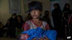 罗兴亚人逃离暴力 缅甸领导人取消联合国发言