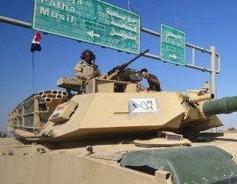 英语访谈节目:伊拉克政府军与库尔德武装处于对峙状态