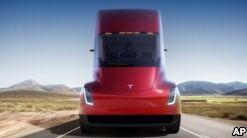 VOA慢速英语:特斯拉推出电动卡车并升级了跑车