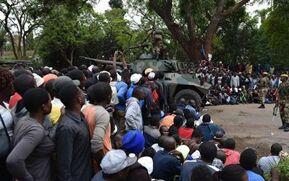 BBC在线收听下载:津巴布韦民众集会游行 要求总统穆加贝辞职