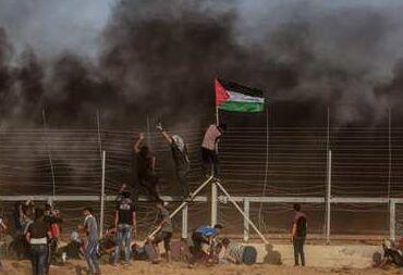 国际英语新闻:Palestinians hold 13th anti-Israel Friday rally in eastern Gaza