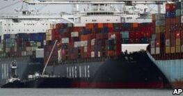 VOA慢速英语:中国督促美国在华企业就贸易战游说政府