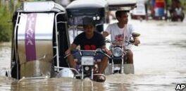 VOA慢速英语:超强台风山竹袭击菲律宾和中国后减弱