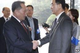 VOA慢速英语:朝韩同意铁路公路通车