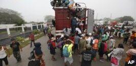 VOA慢速英语:墨西哥移民群体向美国边境挺进