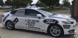 VOA慢速英语:福特与沃尔玛致力于无人驾驶运输车