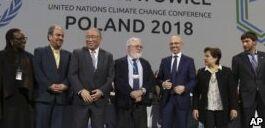 VOA慢速英语:谈判代表同意将巴黎气候协议付诸实施