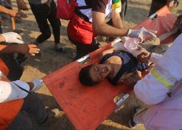 国际英语新闻:34 Palestinians injured in clashes with Israeli soldiers in eastern Gaza