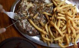 VOA慢速英语:素食者在爱肉的阿根廷获得追随者