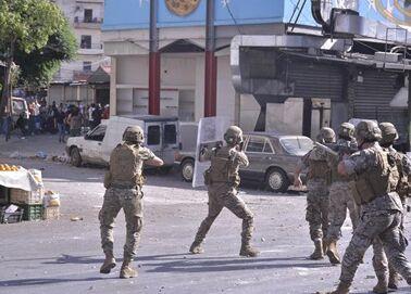 国际英语新闻:Protests in Lebanon's Tripoli leave 20 people injured